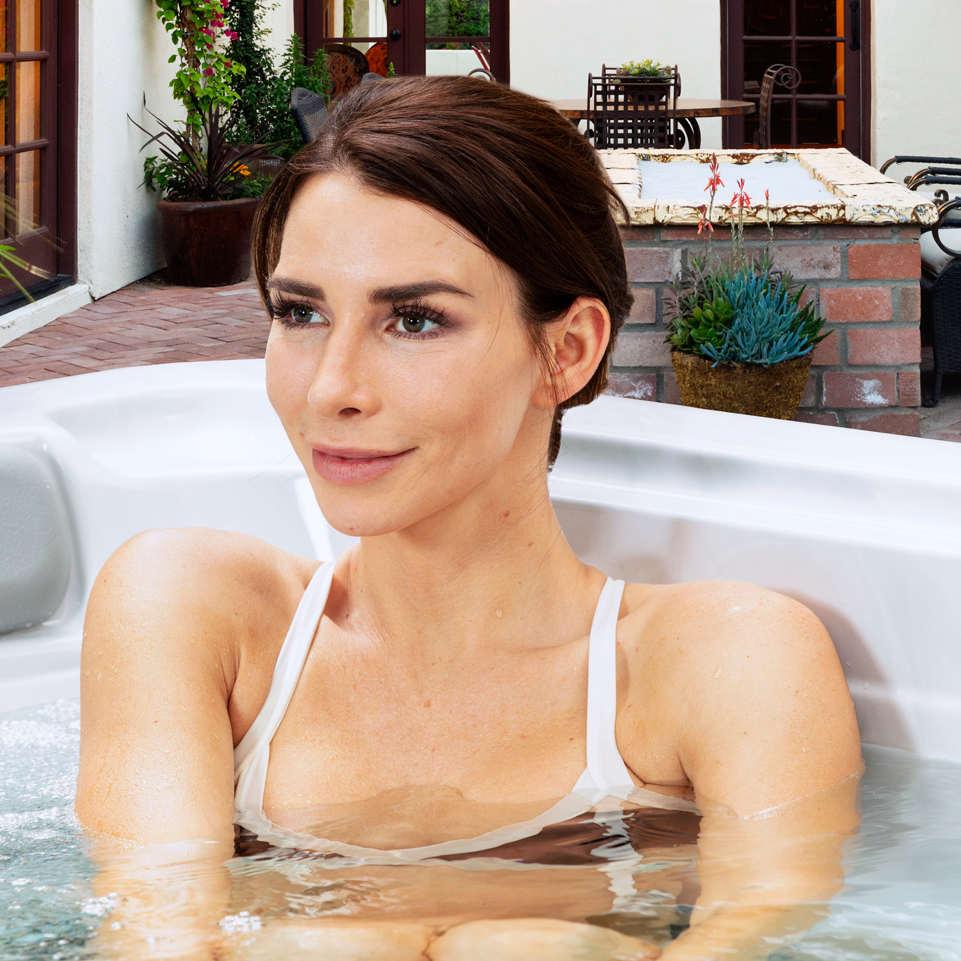 Woman Relaxing In Garden Spa